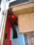 Back seat and engine-compartment fire extinguisher